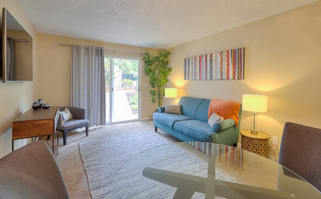 Spacious and bright living room at The Boulevard at South Station Apartment Homes