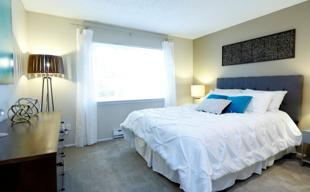 Bright and well-decorated bedroom in model home at Discovery Landing Apartment Homes