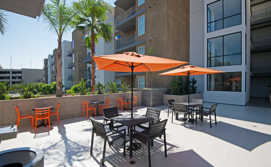 Shaded seating and plenty of space at rooftop patio area at IMT Sherman Circle in Van Nuys, California
