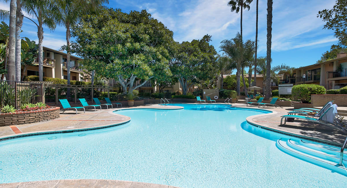 Resort-style swimming pool on another sunny day at Mediterranean Village Apartments in Costa Mesa, California