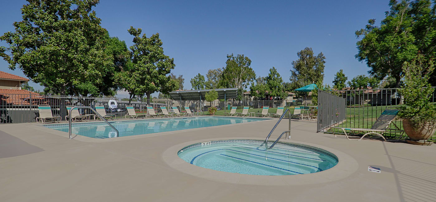 Sparkling swimming pool and hot tub area at Country Hills Apartment Homes in Corona, CA