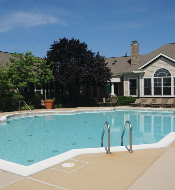 Resort-style pool at The Village at Potomac Falls Apartment Homes in Sterling, Virginia