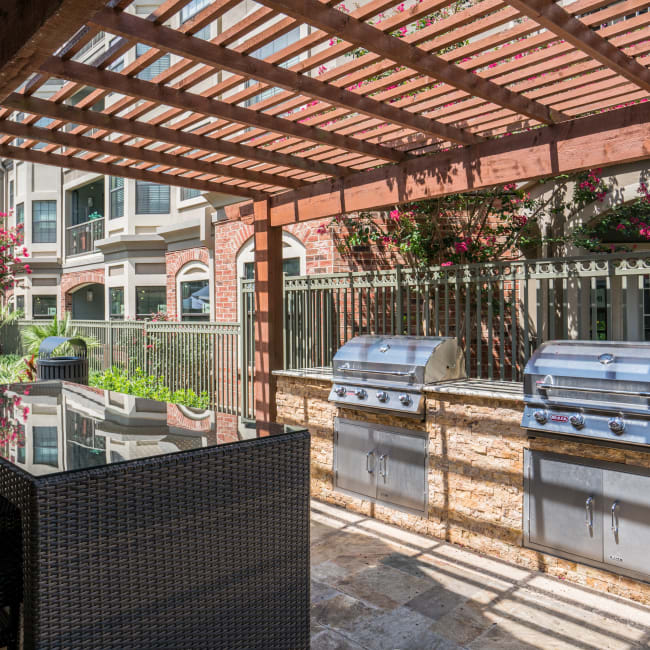 Outdoor grill with bar seating at The JaXon in Kingwood, Texas