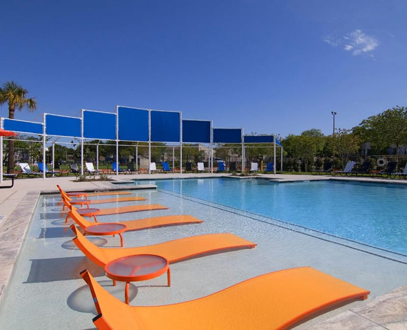 Poolside seating at 2111 Holly Hall in Houston, Texas
