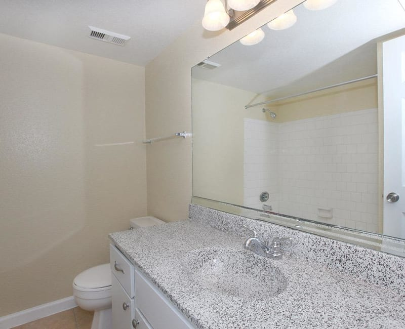 Clean, bright bathroom at Roundhill Townhomes in Houston, Texas
