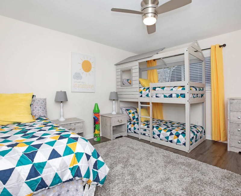 Bedroom with a ceiling fan at Roundhill Townhomes in Houston, Texas