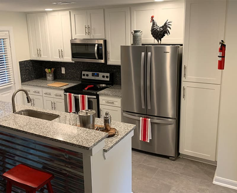 Kitchen with stainless steel appliances at Roundhill Townhomes in Houston, Texas