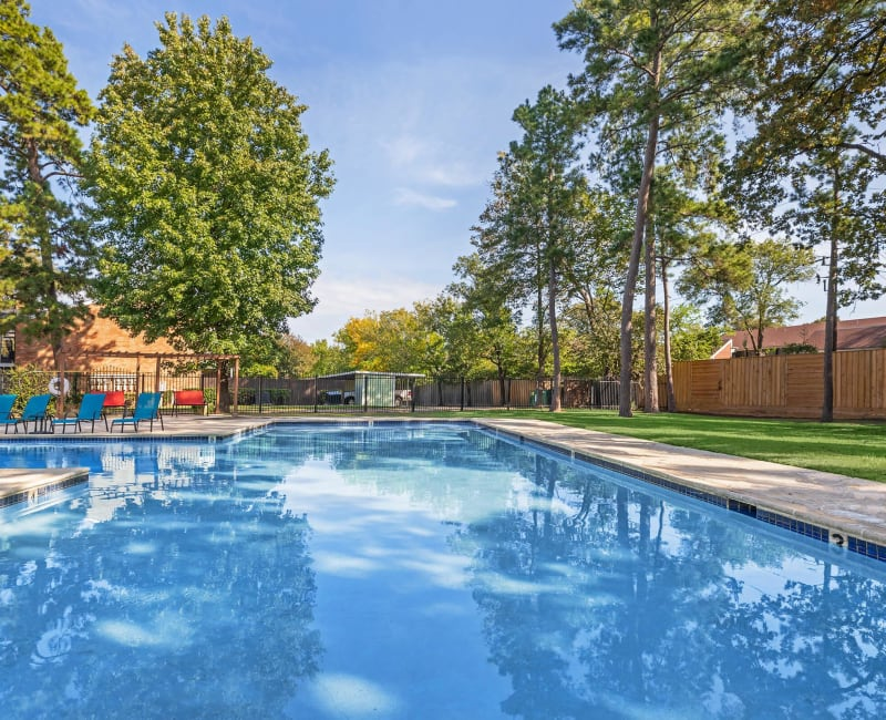 Outdoor swimming pool at Roundhill Townhomes in Houston, Texas