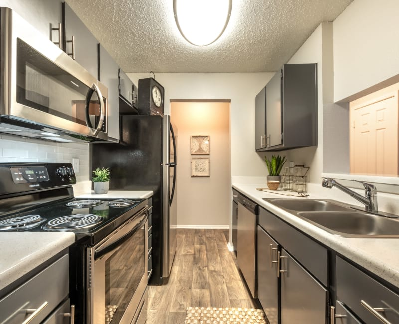 Kitchen with stainless steel appliances at Lane at Towne Crossing in Mesquite, Texas