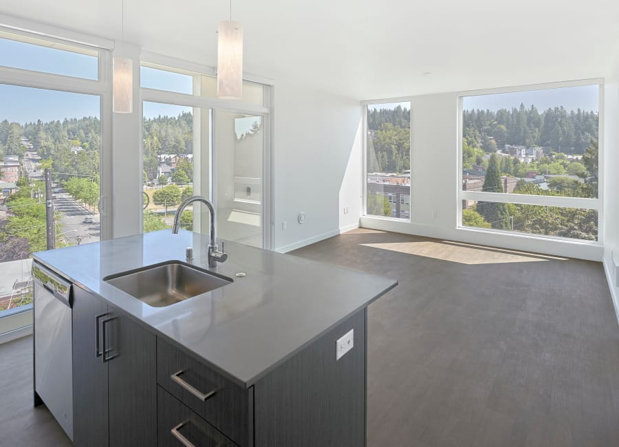 Spacious living room and kitchen at Station House Apartments in Redmond, Washington