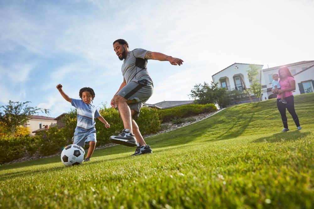 Family playing soccer at BB Living at Eastmark in Mesa, Arizona