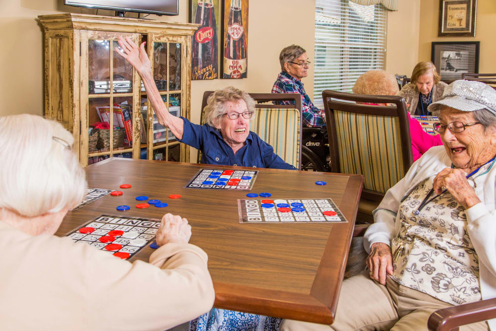 Residents play bingo together at Park Wood Retirement Community