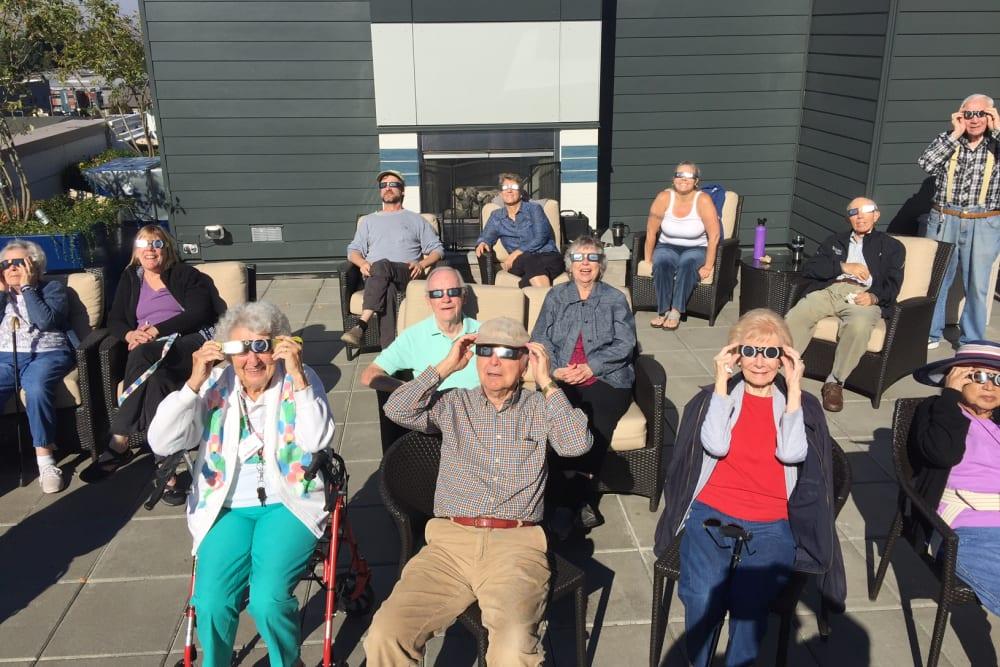Watching the solar eclipse at Merrill Gardens at Ballard in Seattle, Washington.