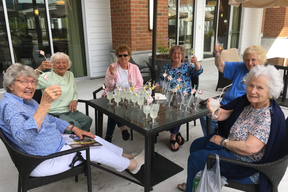 Resident friends enjoying a meal at Merrill Gardens at Burien in Burien, Washington.