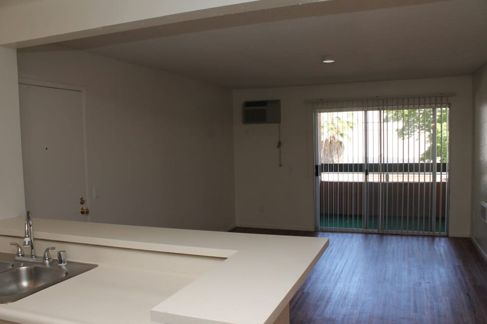 Empty apartment with hardwood flooring at Brookhollow Apartments in West Covina CA
