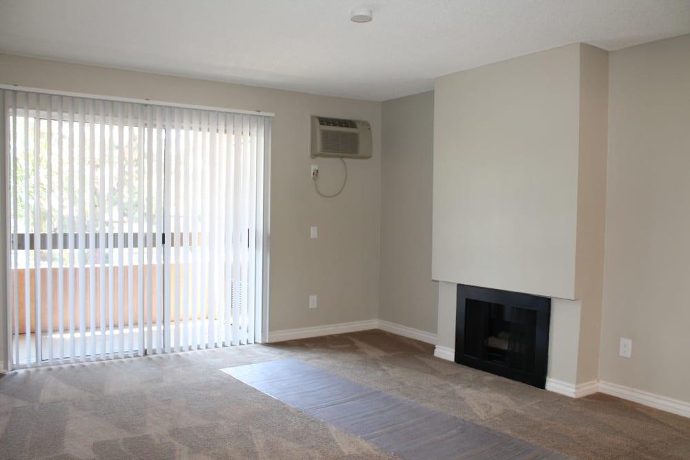 Empty apartment living room with hardwood floors