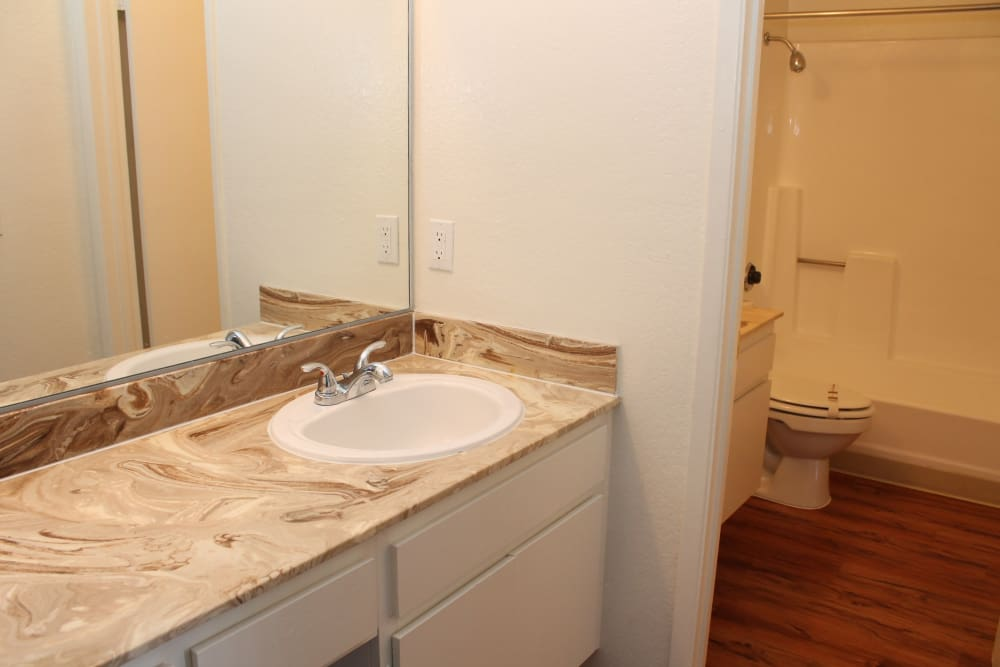 High end restrooms with hardwood flooring at Brookhollow Apartments