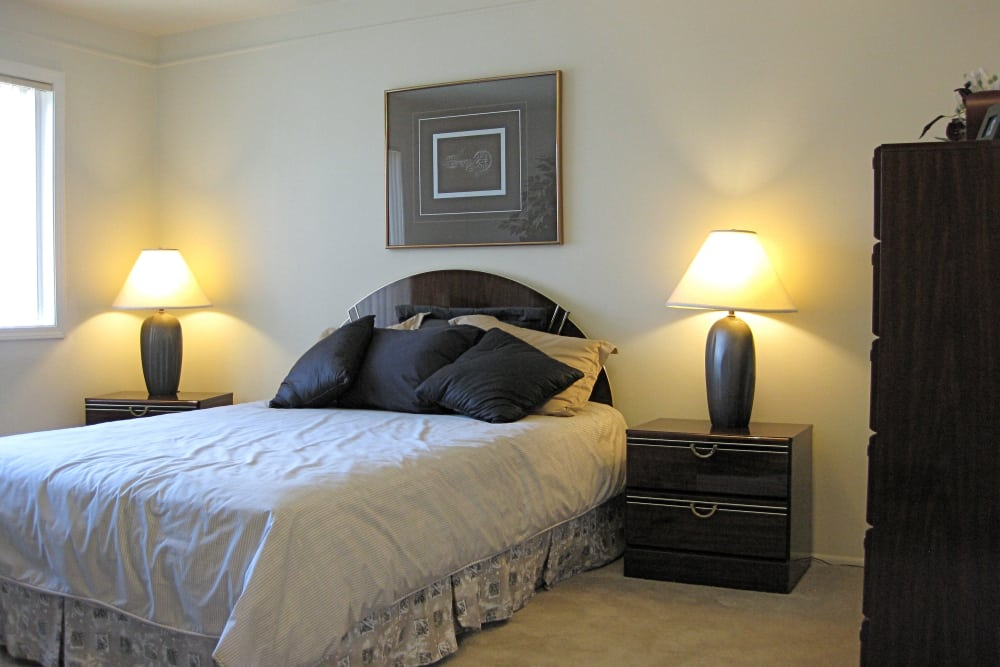 Comfy bed at The Meadows on Balfour apartments in Harper Woods, MI