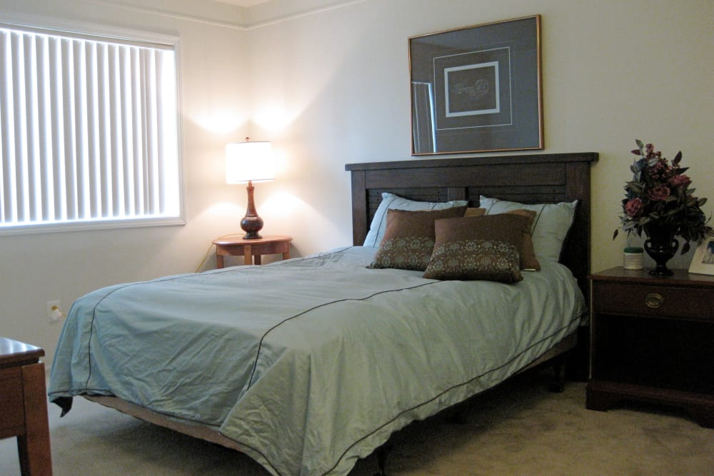 Well decorated bedroom at The Meadows on Balfour apartments in Harper Woods, MI