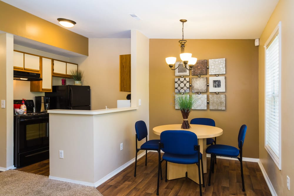 Dining area and kitchen at The Meadows apartments in Ypsilanti