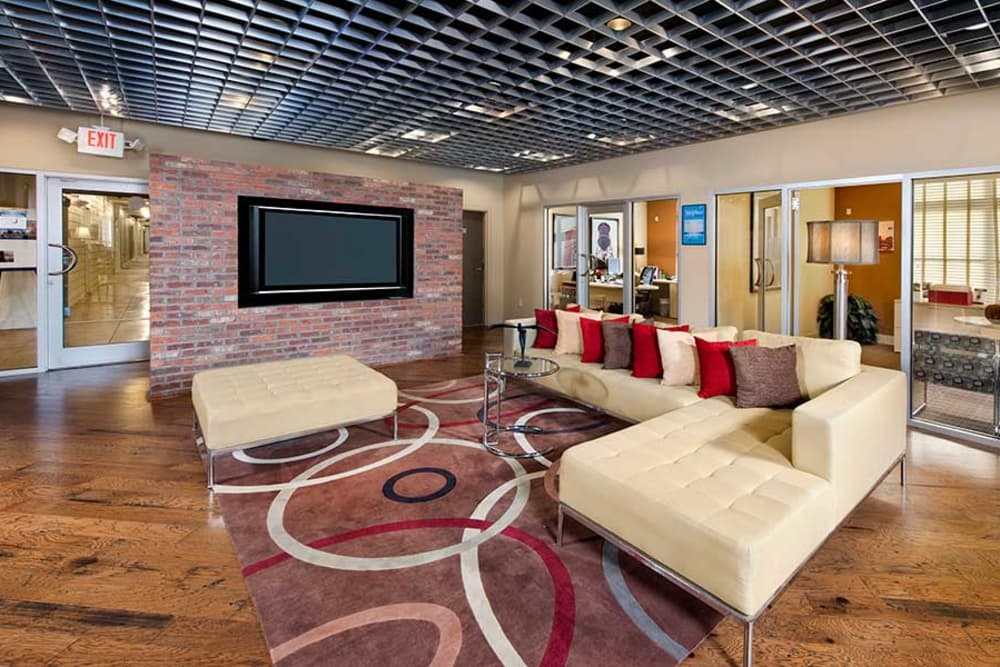 Comfy sofas and abstract area rugs decorate The Atlantic Aerotropolis