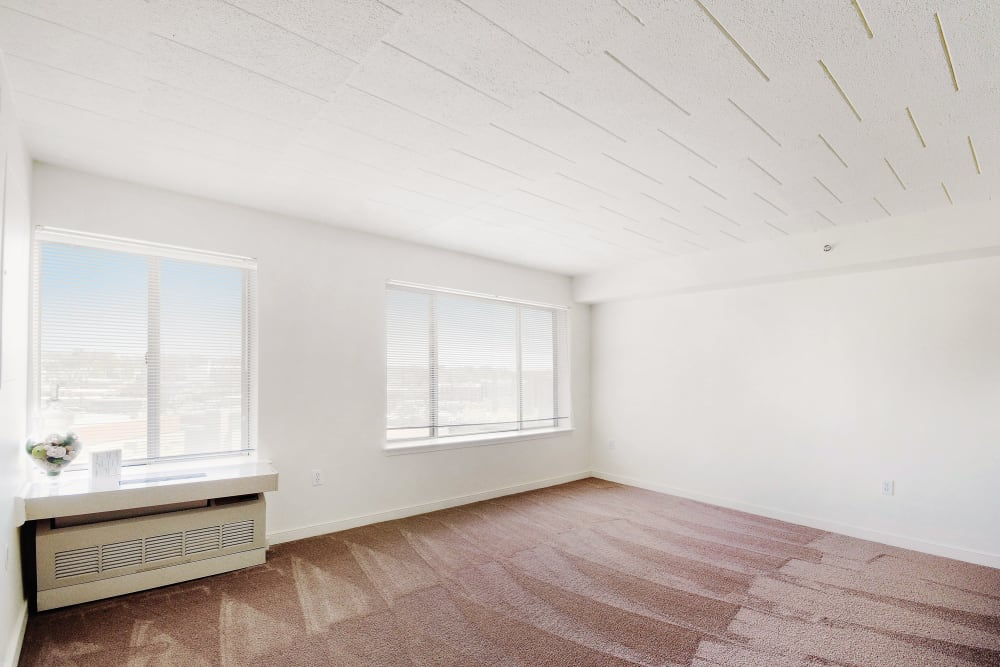 Carpeted room with air conditioner at Edgewood Commons
