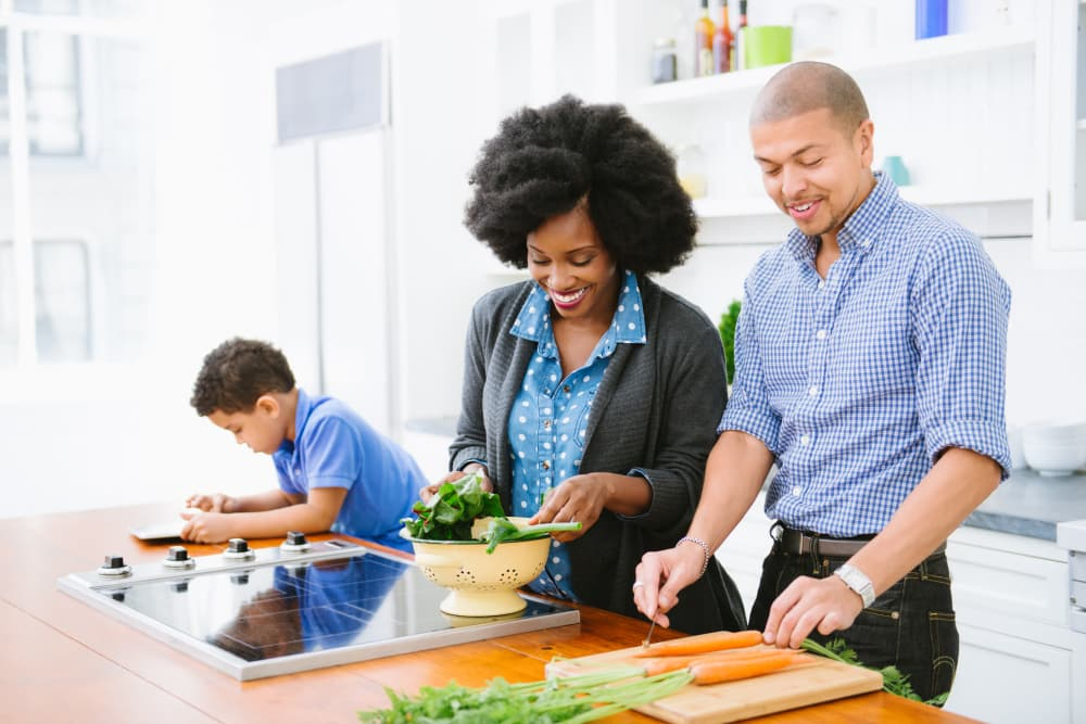 Family cooking together at Parkchester Apartments