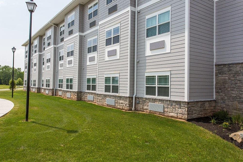 Exterior view of apartment building at Villa Capri Senior Apartments in Rochester, NY