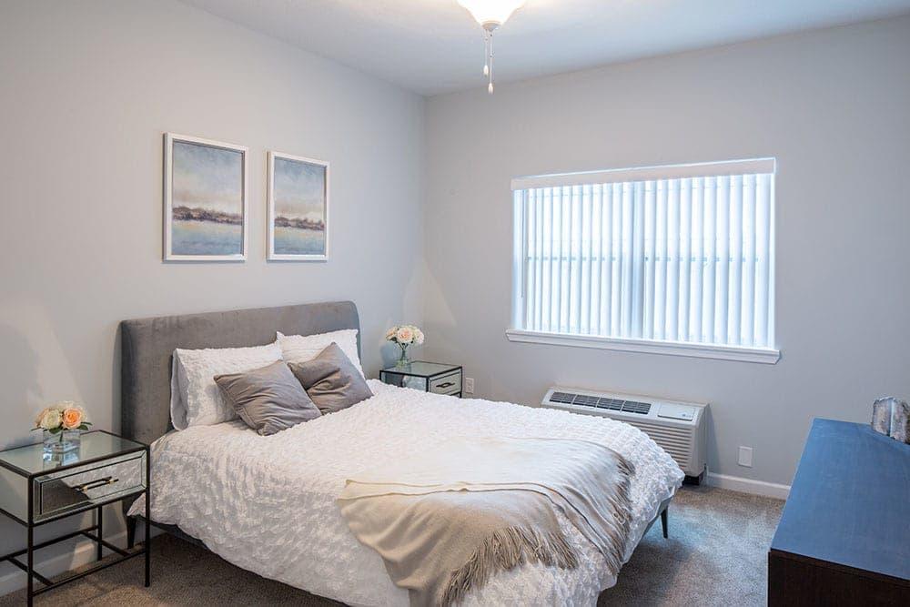 Villa Capri Senior Apartments offers a cozy bedroom in Rochester, NY