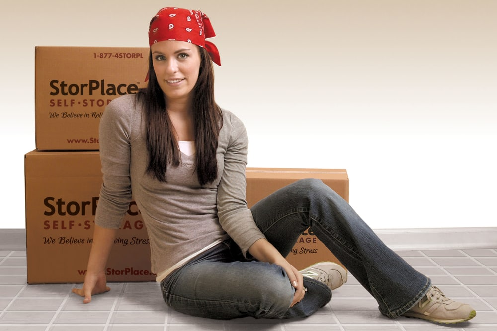 Customer posing in front of her moving boxes at StorPlace of Medical Center in Nashville, Tennessee