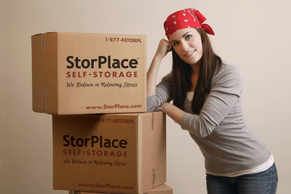 Customer using packing boxes from StorPlace of Medical Center in Nashville, Tennessee to pack up her items