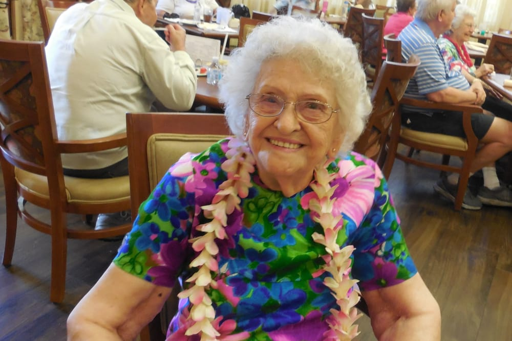 Resident enjoying a Luau at The Groves, A Merrill Gardens Community in Goodyear, Arizona.