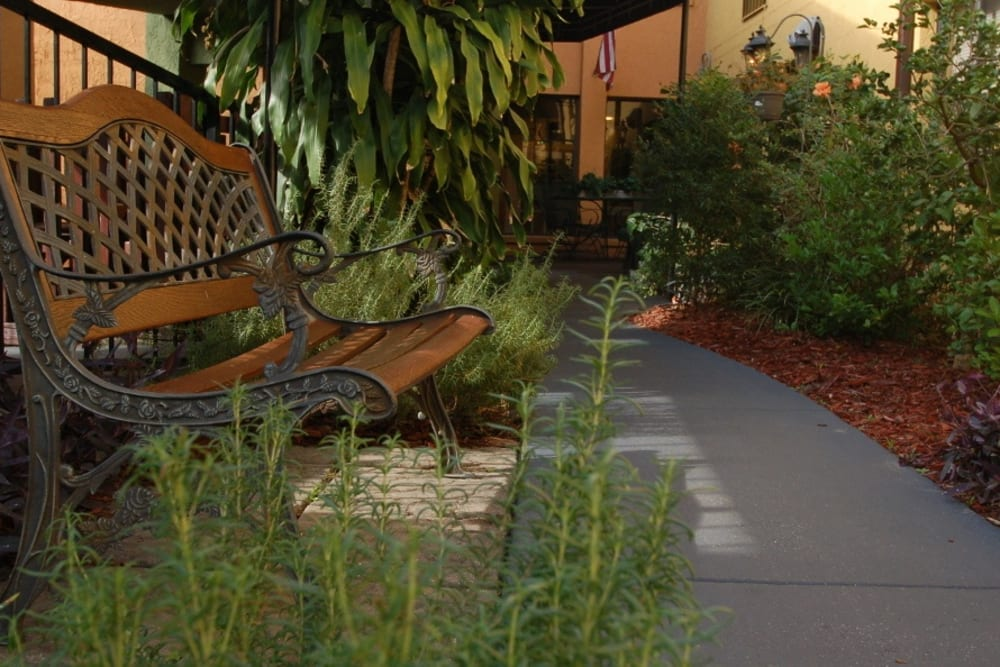 Bench by pathway at Grand Villa of Altamonte Springs in Florida