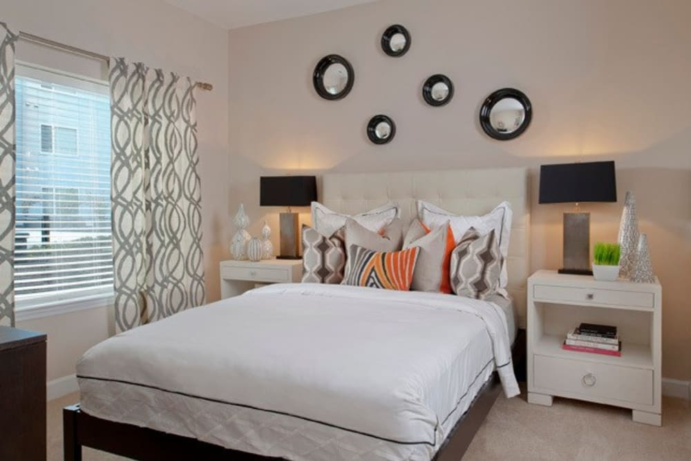 Modern furnished bedroom with lots of natural light at The Galaxy in Silver Spring, Maryland