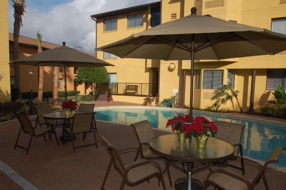 Patio furniture by the pool at Grand Villa of Altamonte Springs in Florida