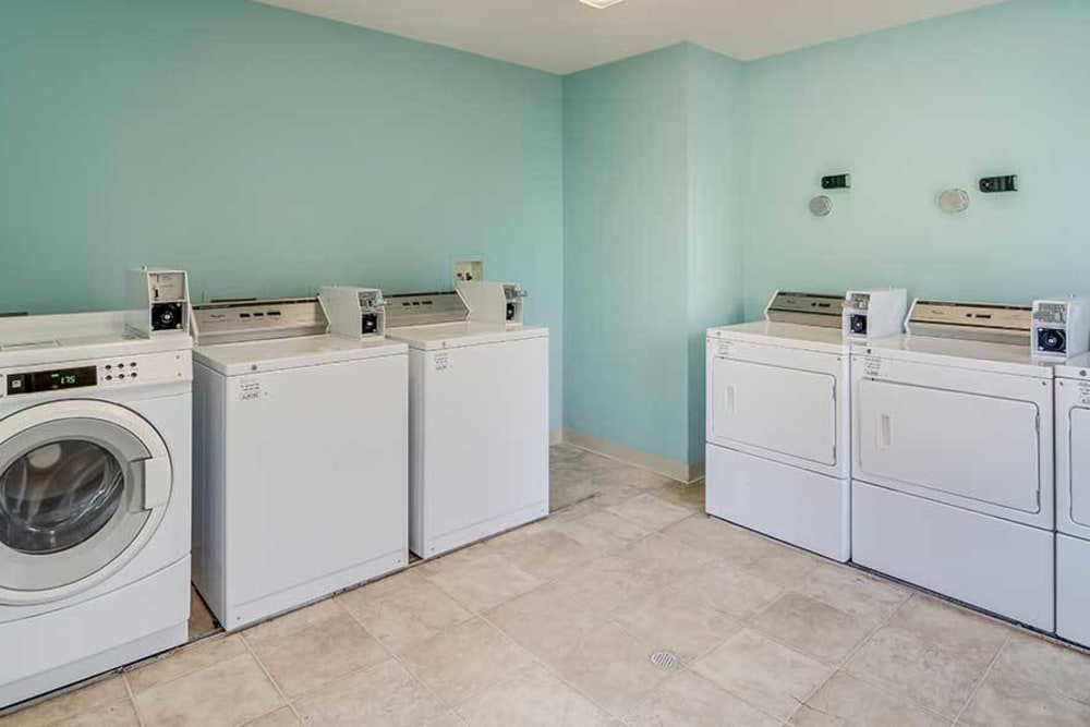 A laundry facility with a couple machines at Creekpointe in Midlothian, Virginia