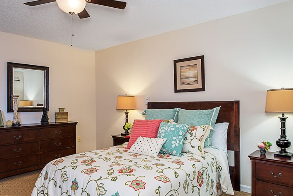 Bedroom model with blue accents at Grand Villa of Englewood in Florida