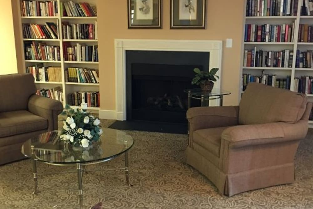 A comfortable clubhouse lounge with a fireplace at Atlantic at Charter Colony in Midlothian, Virginia
