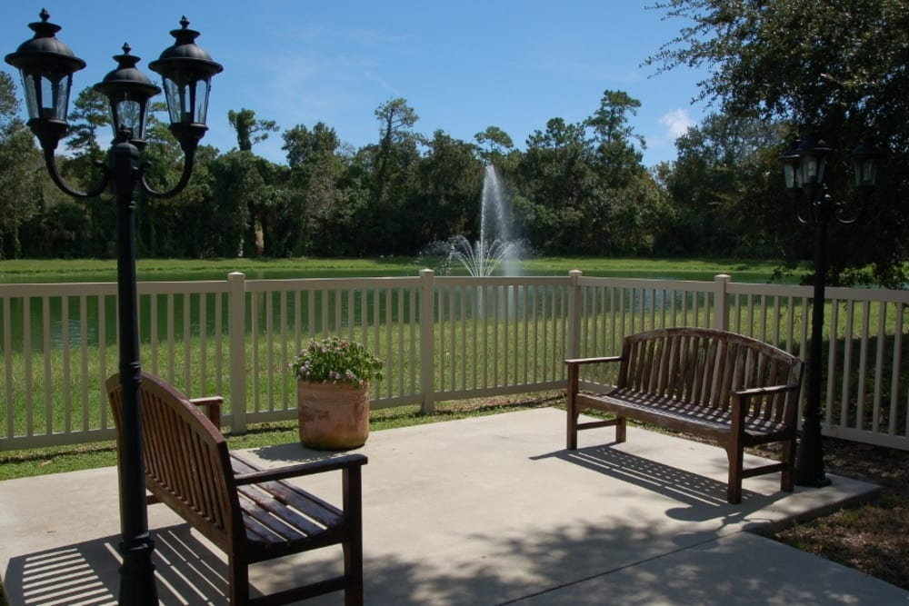 Outdoor seating with fountain view at Grand Villa of Ormond Beach in Florida