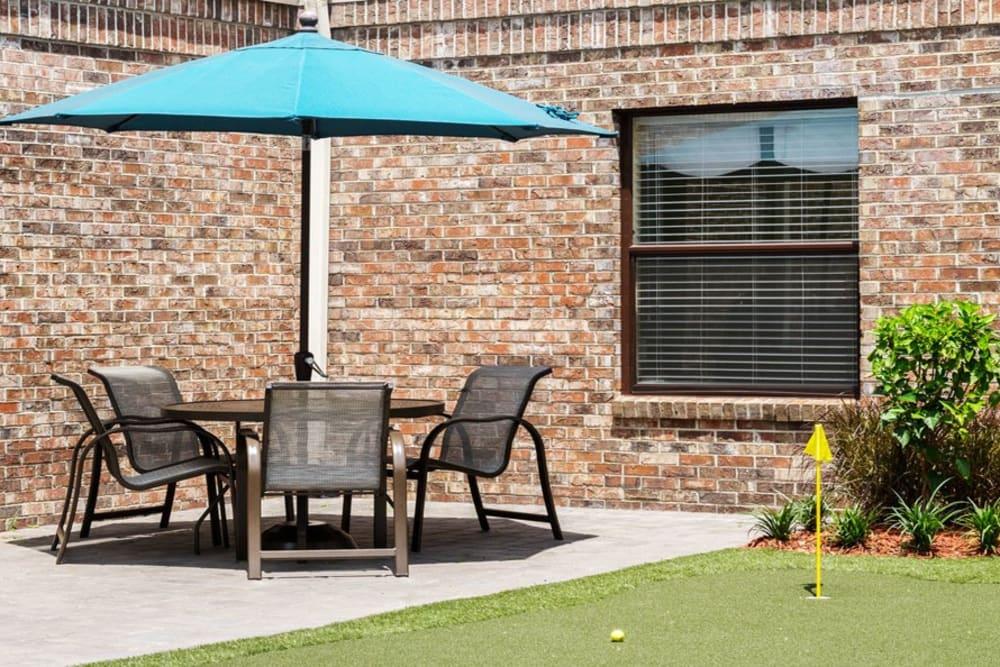 Sunny patio furniture at Grand Villa of Ormond Beach in Florida