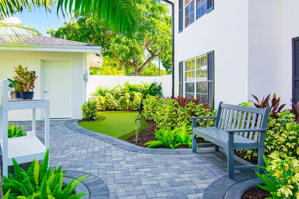Green pathway outside Grand Villa of Delray East in Florida