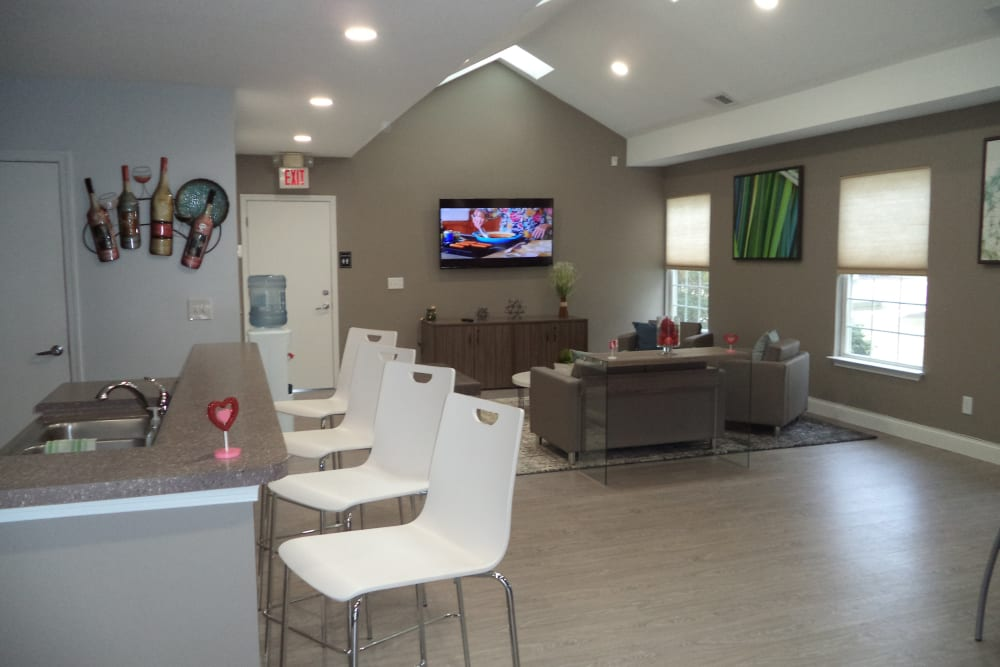 A clubhouse with bar seating at The Glenn's at Millers Lane in Henrico, Virginia
