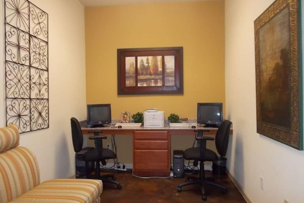 A business center with complimentary computers at Woodside Manor in Conroe, Texas