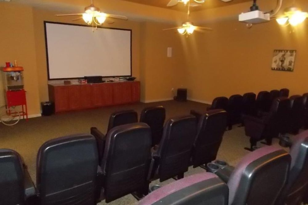 A community theater for movie nights at Woodside Manor in Conroe, Texas