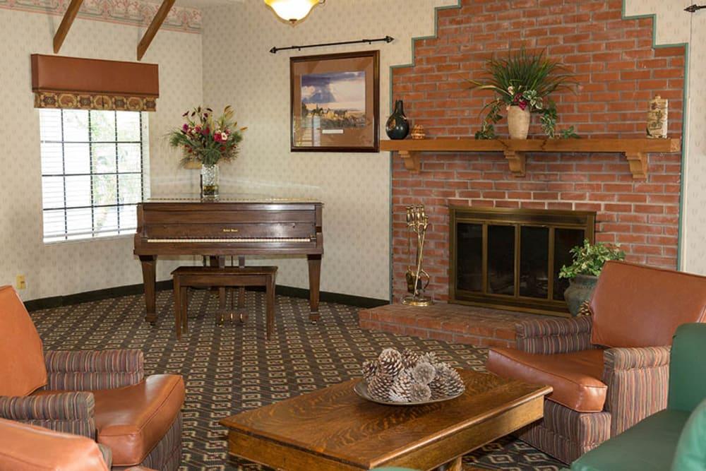 Pre-renovated lounge at Del Obispo Terrace Senior Living in San Juan Capistrano, CA