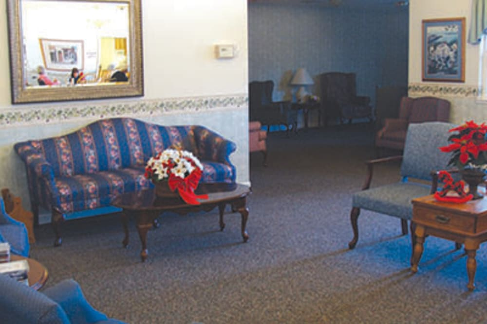 Seating area with blue chairs at Oak Terrace Memory Care in Soulsbyville, California
