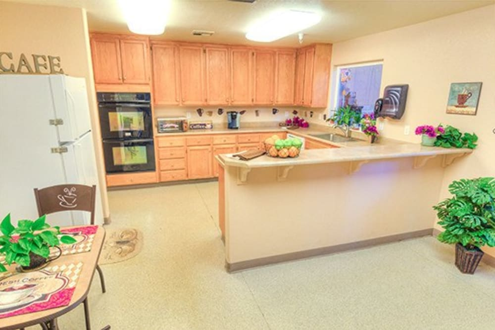 Kitchen area in residential apartment at Oak Terrace Memory Care in Soulsbyville, California