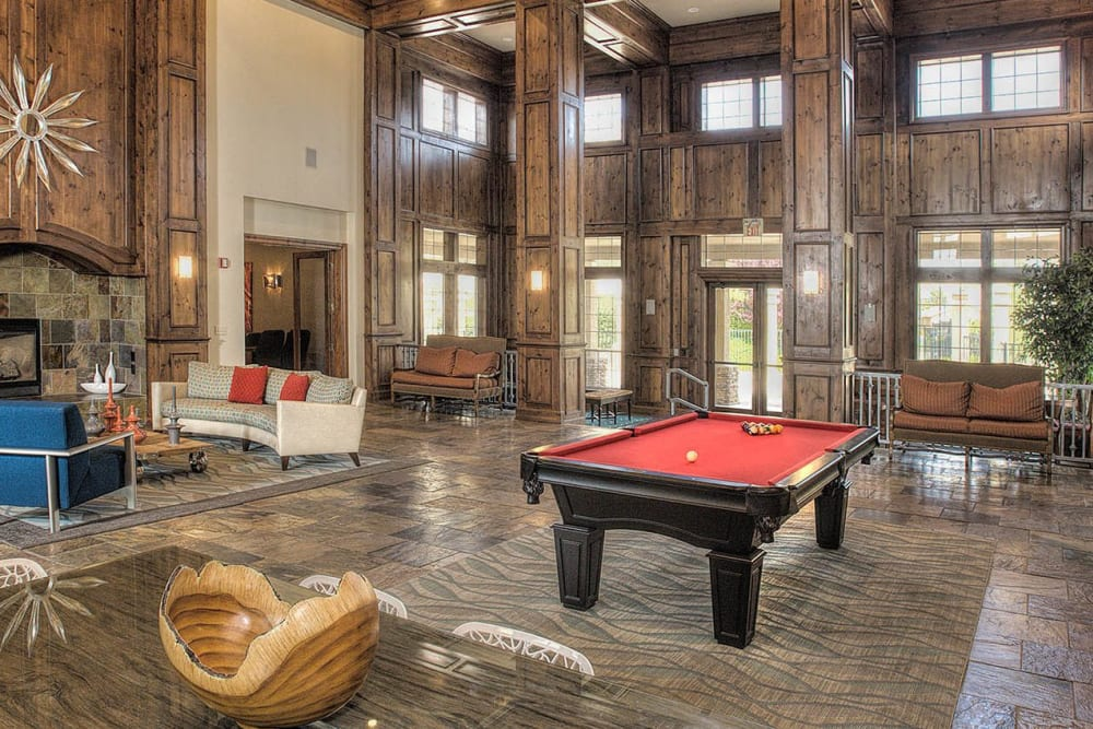 Resident clubhouse with a billiards table and lounge at The Vintage at South Meadows Condominium Rentals in Reno, Nevada