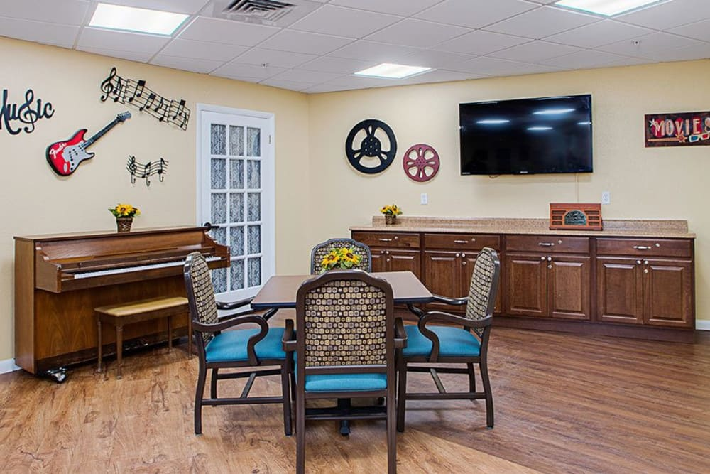 TV and piano room at Grand Villa of Lakeland in Florida
