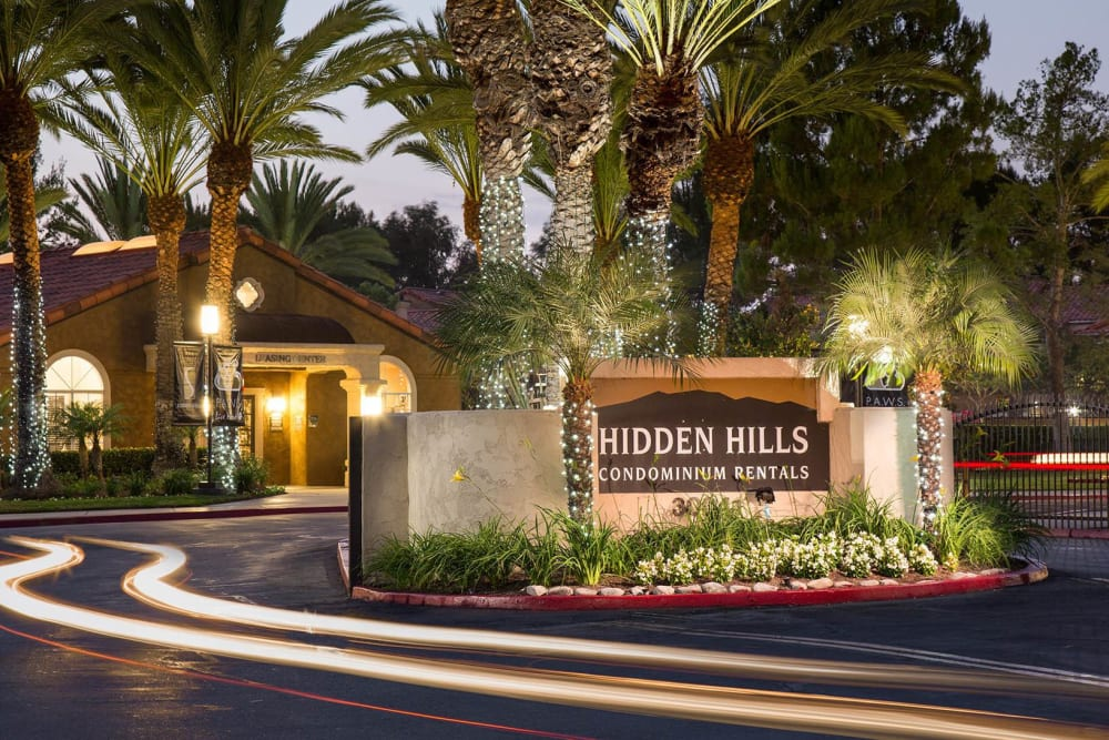 Apartment sign at dusk at Hidden Hills Condominium Rentals in Laguna Niguel, California
